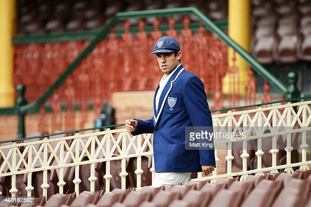 Blues captain Moises Henriques walks out to conduct the coin toss during day one of the Sheffield Shield match between New South Wales and Queensland...
