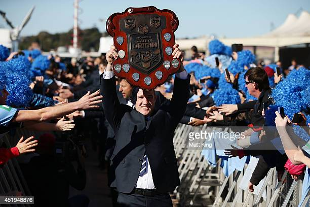 Blues captain Paul Gallen celebrates with fans and holds the State of Origin trophy during the NSW Blues State of Origin series victory celebrations...