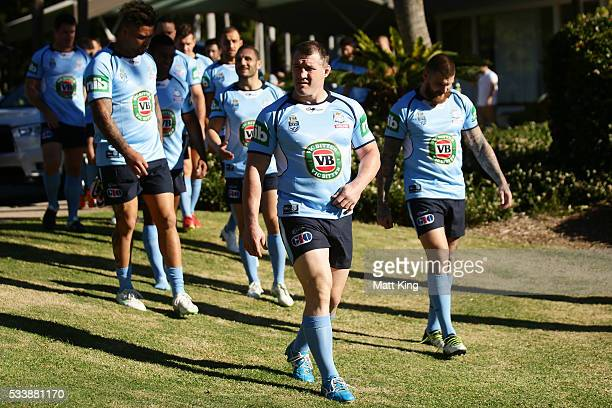 Blues captain Paul Gallen leads the team to a New South Wales Blues NRL State of Origin team photo session at The Novatel on May 24 2016 in Coffs...