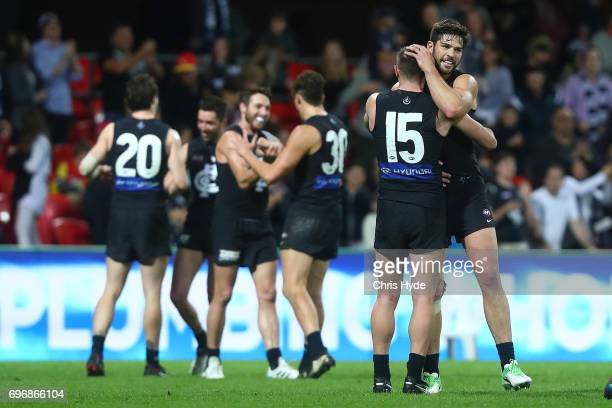 Blues celebrate winning the round 13 AFL match between the Gold Coast Suns and the Carlton Blues at Metricon Stadium on June 17 2017 in Gold Coast...