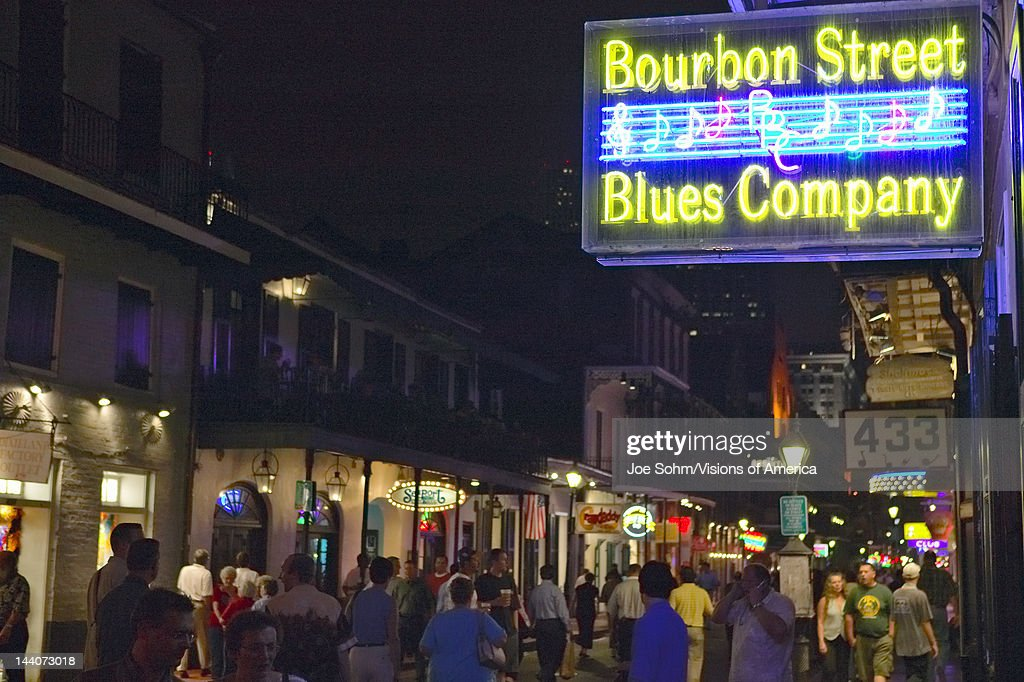 Blues club and neon lights on Bourbon Street in French Quarter of New Orleans Louisiana