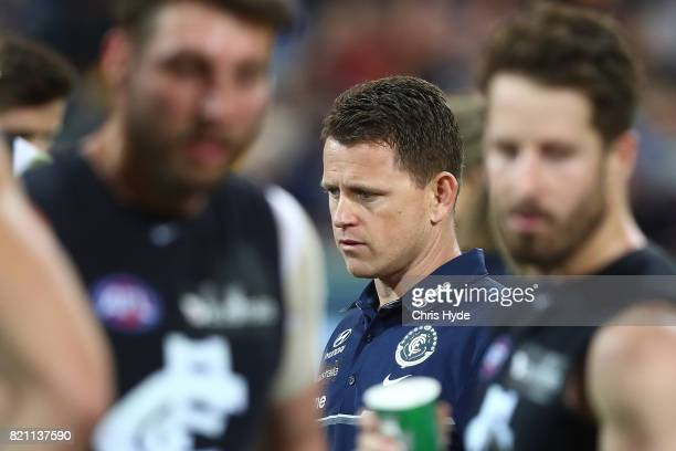 Blues coach Brendon Bolton talks to players during the round 18 AFL match between the Brisbane Lions and the Carlton Blues at The Gabba on July 23...