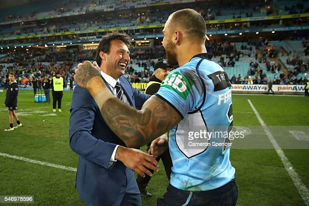 Blues coach Laurie Daley congratulates Blake Ferguson of the Blues after game three of the State Of Origin series between the New South Wales Blues...