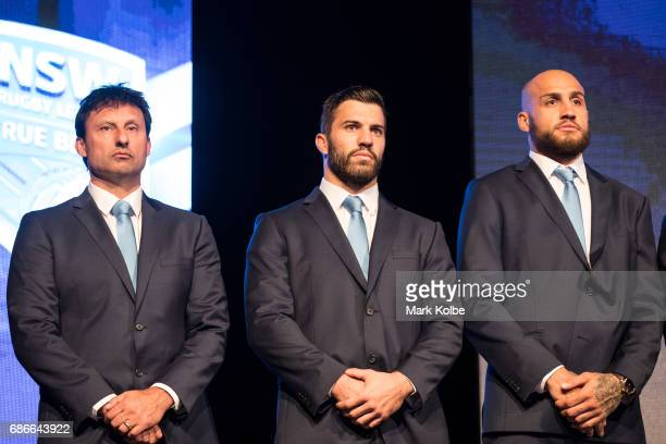 Blues coach Laurie Daley James Tedesco and Blake Ferguson stand on stage during the New South Wales State of Origin team announcement at The Star on...