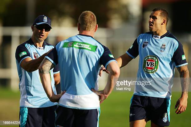 Blues coach Laurie Daley speaks to Luke Lewis and Blake Ferguson during a New South Wales Blues State of Origin training session at Coogee Oval on...