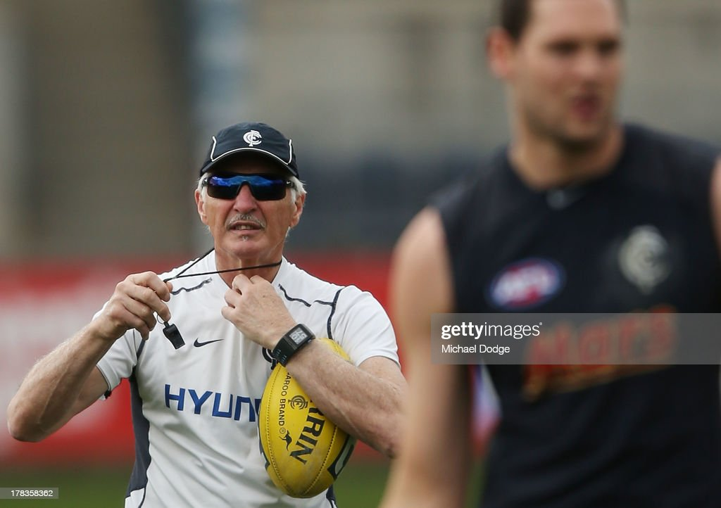 Blues coach Michael Malthouse adjusts his whistle during a Carlton Blues AFL training session at Visy Park on August 30, 2013 in Melbourne, Australia.