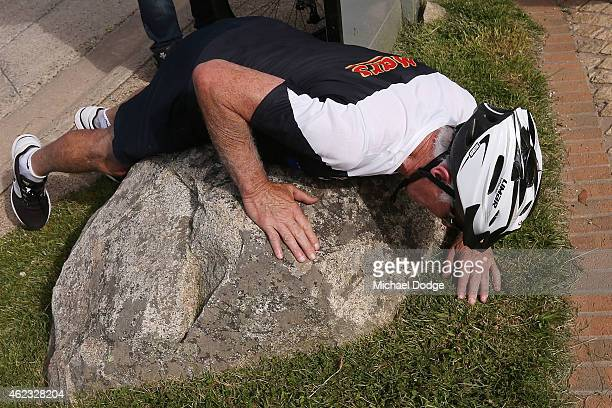 Blues coach Michael Malthouse lays on a rock after riding up Mount Buller during the Carlton Blues AFL training camp on January 27 2015 in Mount...
