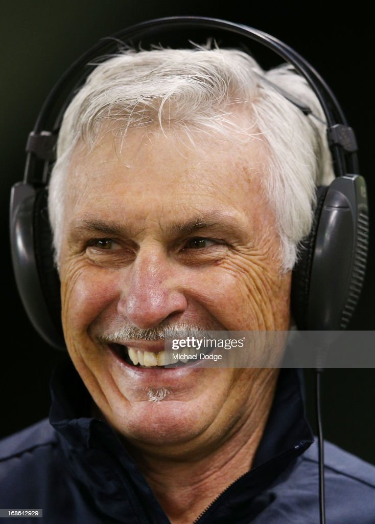 Blues coach Michael Malthouse reacts when talking on air to a radio station during the round seven AFL match between the St Kilda Saints and the Carlton Blues at Etihad Stadium on May 13, 2013 in Melbourne, Australia.