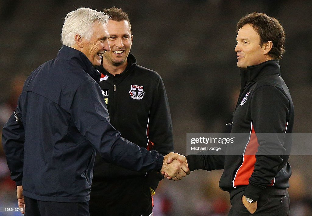 Blues coach Michael Malthouse (L) shakes hands with Saints coach Scott Watters during the round seven AFL match between the St Kilda Saints and the Carlton Blues at Etihad Stadium on May 13, 2013 in Melbourne, Australia.