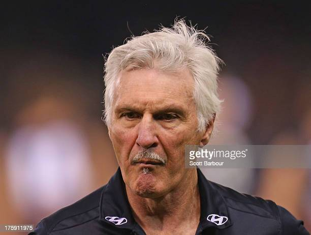 Blues coach Mick Malthouse leaves the ground after speaking to his team during the round 20 AFL match between the Carlton Blues and the Western...