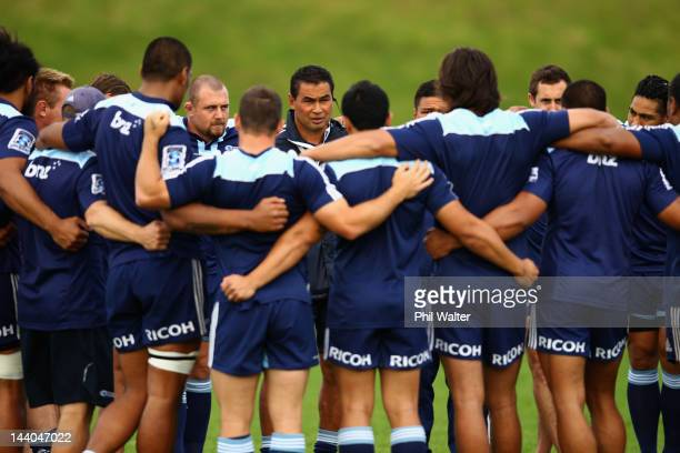 Blues coach Pat Lam gathers the team for a talk during an Auckland Blues Super Rugby training session at Unitec on May 9 2012 in Auckland New Zealand
