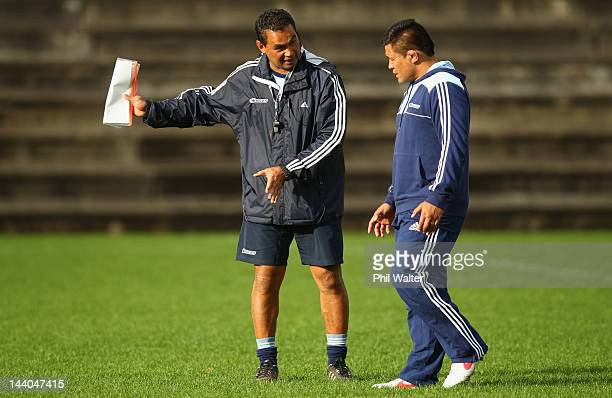 Blues coach Pat Lam talks with Keven Mealamu during an Auckland Blues Super Rugby training session at Unitec on May 9 2012 in Auckland New Zealand