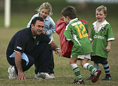 Blues coach Ricky Stuart plays with his children during a New South Wales Blues State of Origin training session at Woolahra Oval on June 10 2005 in...
