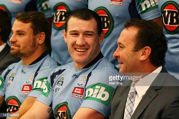 Blues coach Ricky Stuart talks to Paul Gallen during the New South Wales Blues State of Origin team photo at Crown Plaza Coogee on June 26 2012 in...