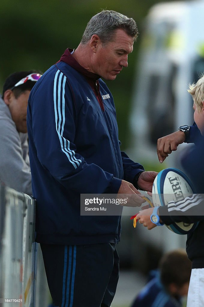 Blues Coach Sir John Kirwan talks to children during the Pacific Rugby Cup match between the Blues Development and Junior Japan at Bell Park on March 28, 2013 in Auckland, New Zealand.