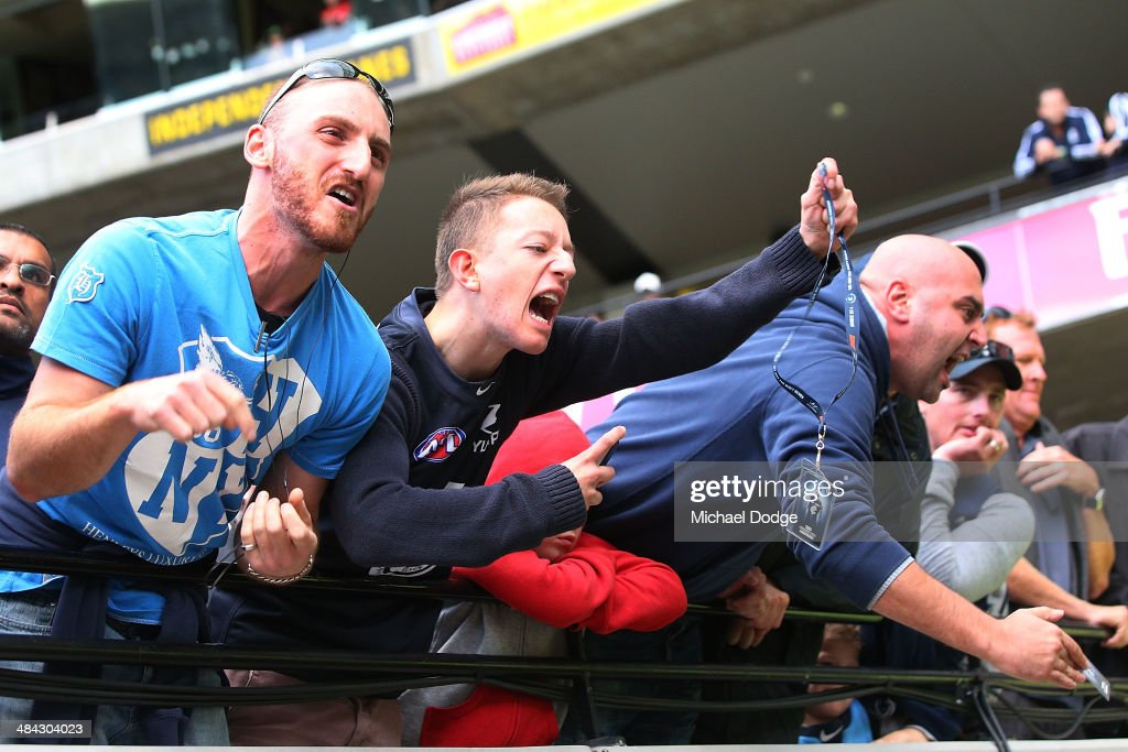 A Blues fan gestures to his membership card after their defeat during the round four AFL match between the Carlton Blues and the Melbourne Demons at Melbourne Cricket Ground on April 12, 2014 in Melbourne, Australia.