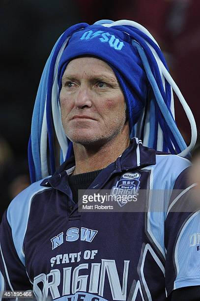 Blues fan looks on during game three of the State of Origin series between the Queensland Maroons and the New South Wales Blues at Suncorp Stadium on...