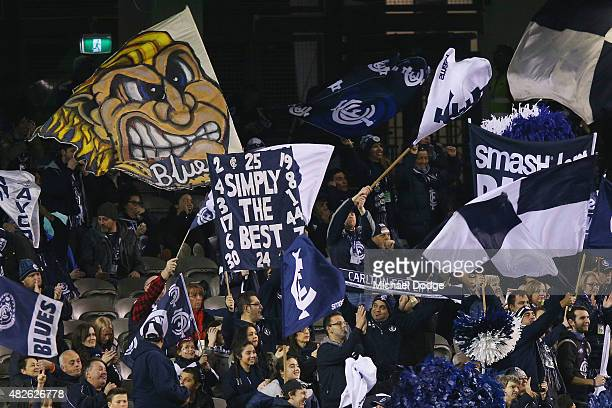 Blues fans celebrate a goal during the round 18 AFL match between the Carlton Blues and the North Melbourne Kangaroos at Etihad Stadium on August 1...