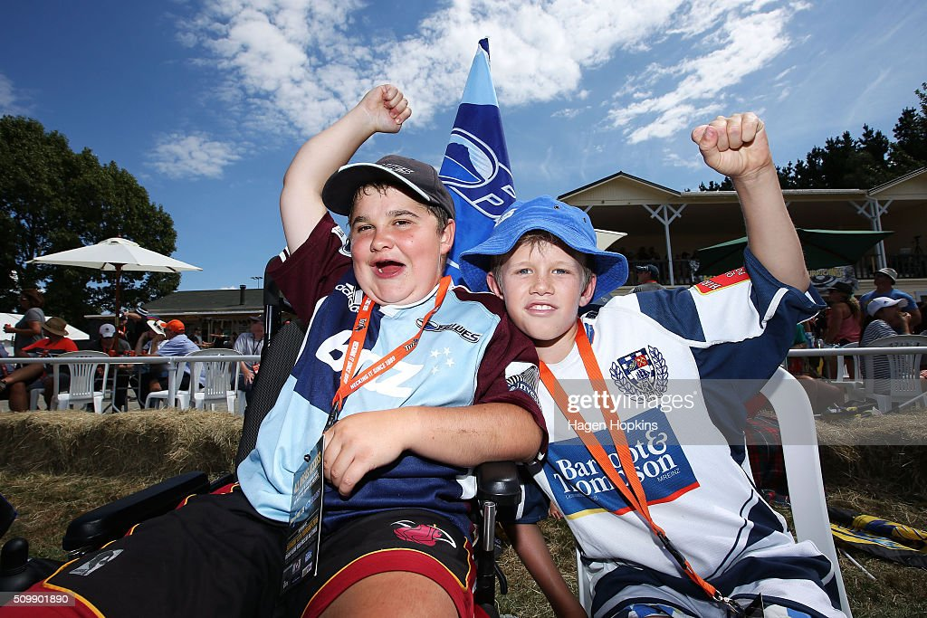 Blues fans Stan Dickson (L) of Masterton, who suffers from muscular dystrophy and cousin Henry Kaye show their support during the Super Rugby pre-season match between the Blues and the Hurricanes at Eketahuna Rugby Club on February 13, 2016 in Eketahuna, New Zealand.