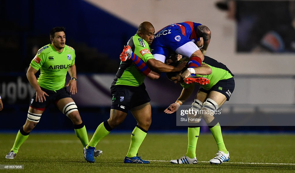 Blues forwards Taufa'ao Filise (c) and Chris Dicomidis (r) combine to stop Rovigo centre Joe Van Niekerk during the European Rugby Challenge Cup match between Cardiff Blues and Rugby Rovigo at Cardiff Arms Park on January 16, 2015 in Cardiff, Wales.