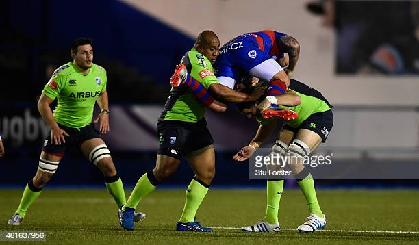 Blues forwards Taufa'ao Filise and Chris Dicomidis combine to stop Rovigo centre Joe Van Niekerk during the European Rugby Challenge Cup match...