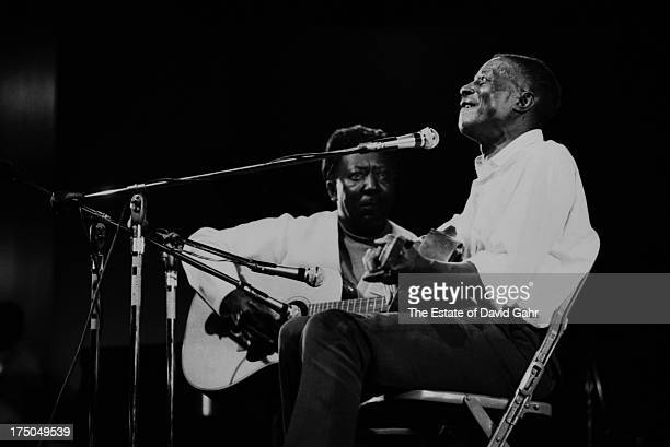 Blues greats Muddy Waters and Son House share the stage at the Newport Folk Festival in July 1969 in Newport Rhode Island