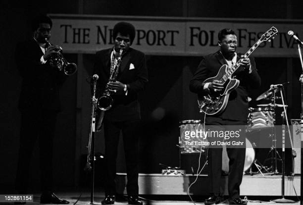 Blues guitarist and singer BB King center performs with his backing band Sonny Freeman and the Unusuals at the Newport Folk Festival in July 1968 in...