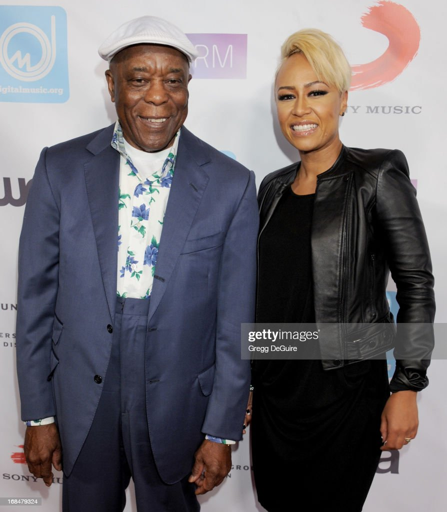 Blues guitarist <a gi-track='captionPersonalityLinkClicked' href=/galleries/search?phrase=Buddy+Guy&family=editorial&specificpeople=215438 ng-click='$event.stopPropagation()'>Buddy Guy</a> and singer Emeli Sande arrive at the NARM Music Biz Awards dinner party at the Hyatt Regency Century Plaza on May 9, 2013 in Century City, California.