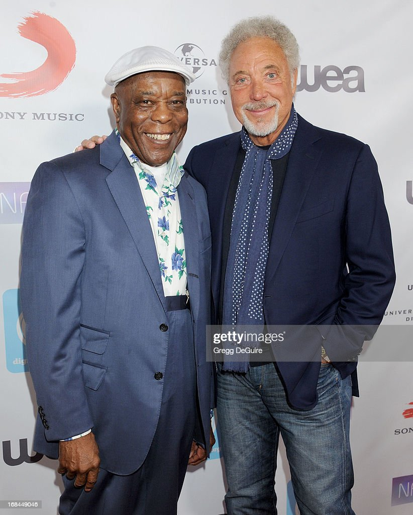 Blues guitarist <a gi-track='captionPersonalityLinkClicked' href=/galleries/search?phrase=Buddy+Guy&family=editorial&specificpeople=215438 ng-click='$event.stopPropagation()'>Buddy Guy</a> and singer Tom Jones arrive at the NARM Music Biz Awards dinner party at the Hyatt Regency Century Plaza on May 9, 2013 in Century City, California.