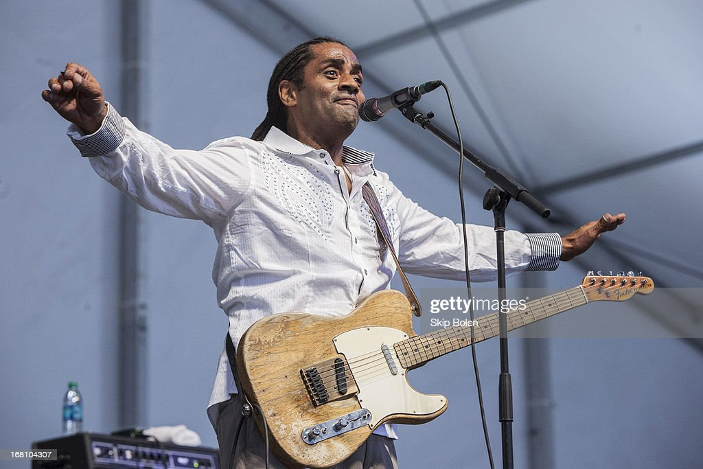 Blues guitarist Kenny Neal performs during the 2013 New Orleans Jazz & Heritage Music Festival at Fair Grounds Race Course on May 4, 2013 in New Orleans, Louisiana.