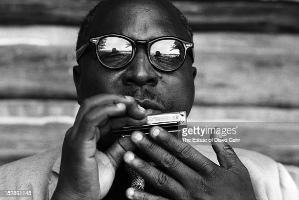 Blues harpist Sonny Terry plays the harmonica in September 1958 at Pete Seeger's cabin home in Beacon New York
