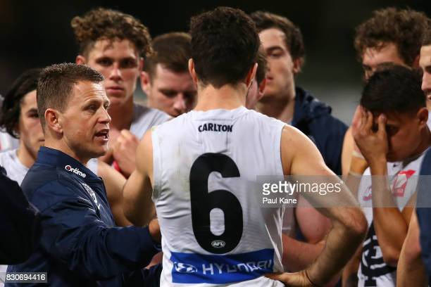 Blues head coach Brendon Bolton addresses players at the three quarter time break during the round 21 AFL match between the West Coast Eagles and the...