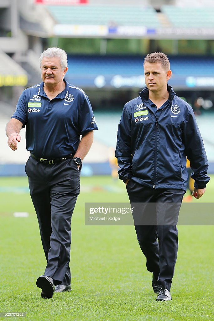 Blues head coach Brendon Bolton (R) and Director of Coaching Neil Craig walk off the ground after an inspection during the round six AFL match between the Carlton Blues and the Essendon Bombers at Melbourne Cricket Ground on May 1, 2016 in Melbourne, Australia.