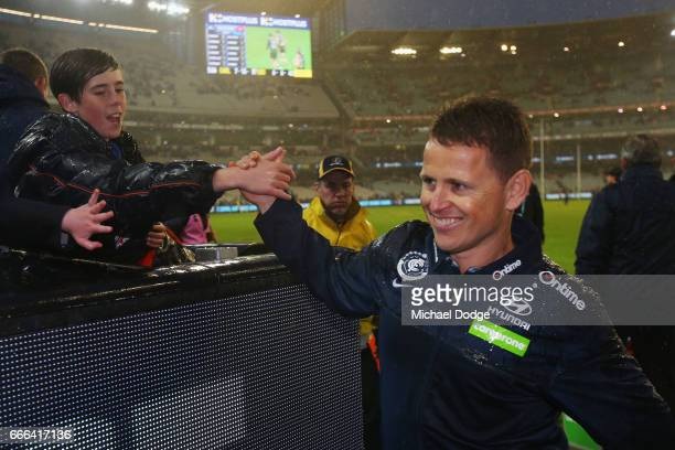 Blues head coach Brendon Bolton celebrates the win with fans during the round three AFL match between the Carlton Blues and the Essendon Bombers at...