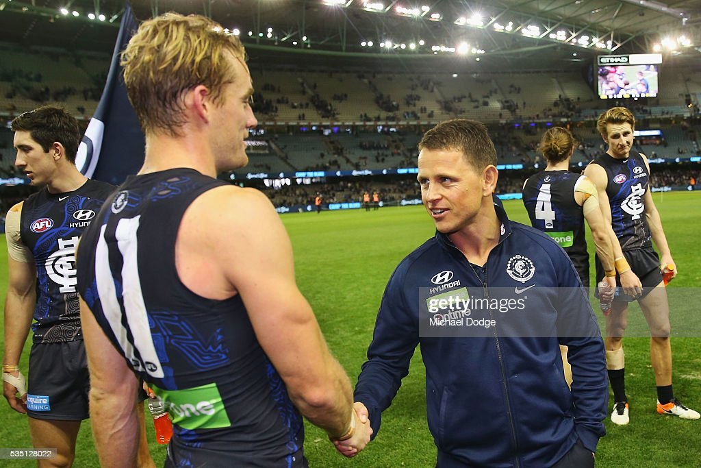 Blues head coach Brendon Bolton celebrates the win with Sam Kerridge of the Blues during the round 10 AFL match between the Carlton Blues and the Geelong Cats at Etihad Stadium on May 29, 2016 in Melbourne, Australia.