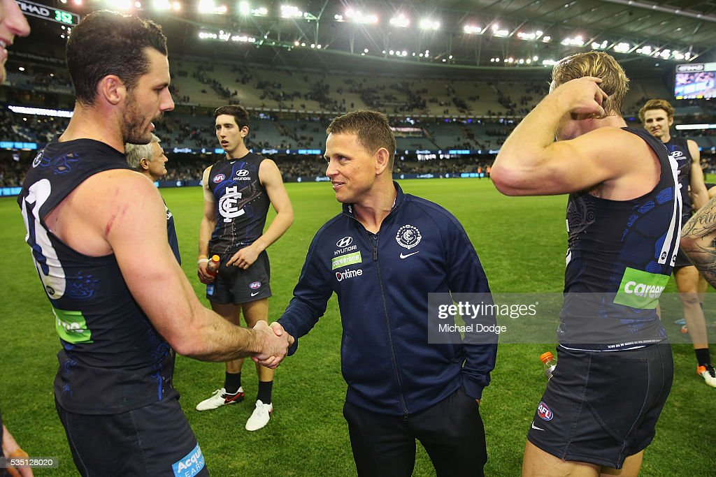 Blues head coach Brendon Bolton celebrates the win with Simon White of the Blues during the round 10 AFL match between the Carlton Blues and the Geelong Cats at Etihad Stadium on May 29, 2016 in Melbourne, Australia.