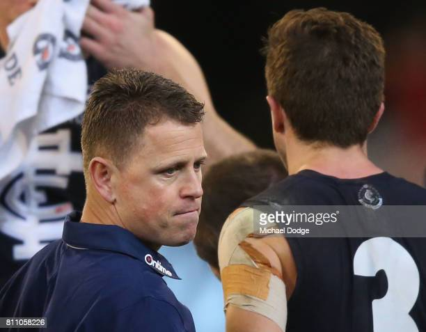 Blues head coach Brendon Bolton leaves at three quarter time during the round 16 AFL match between the Carlton Blues and the Melbourne Demons at...
