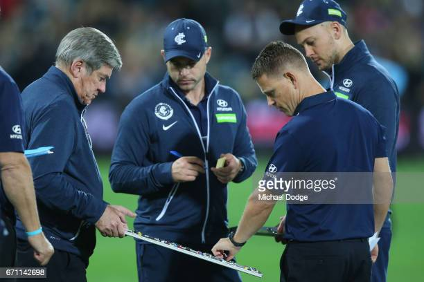 Blues head coach Brendon Bolton looks at his coaching board during the round five AFL match between the Port Adelaide Power and thew Carlton Blues at...