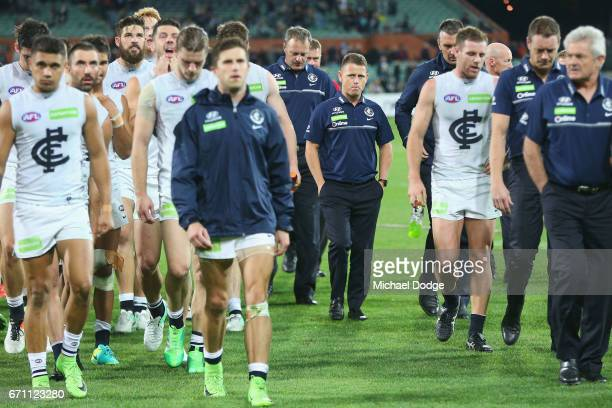 Blues head coach Brendon Bolton looks dejected as Marc Murphy of the Blues leads the team off after defeat during the round five AFL match between...