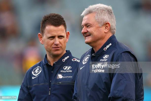 Blues head coach Brendon Bolton looks on with Neil Craig during the round 21 AFL match between the West Coast Eagles and the Carlton Blues at Domain...