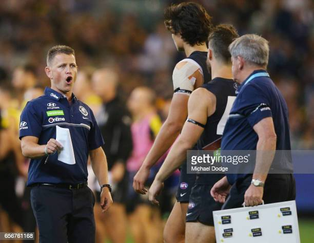 Blues head coach Brendon Bolton looks speaks to Jack Silvagni at quarter time during the round one AFL match between the Carlton Blues and the...