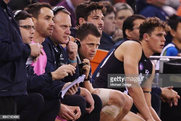 Blues head coach Brendon Bolton looks upfield from the bench during the round 12 AFL match between the Carlton Blues and the Greater Western Sydney...