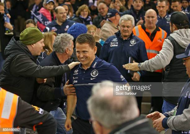 Blues head coach Brendon Bolton smiles as he walks through supporters in the crowd after the Blues won the round 22 AFL match between the Carlton...