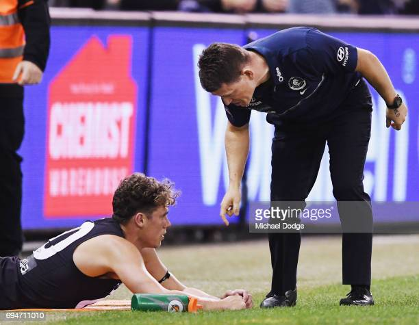 Blues head coach Brendon Bolton speaks to Charlie Curnow of the Blues during the round 12 AFL match between the Carlton Blues and the Greater Western...
