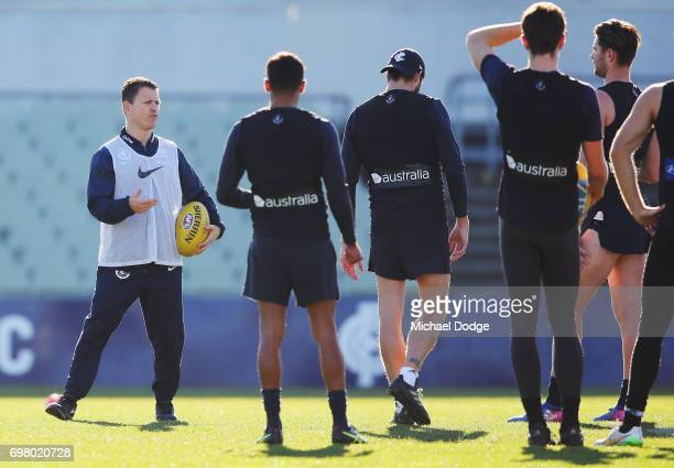 Blues head coach Brendon Bolton speaks to his players during a Carlton Blues AFL training session at Visy Park on June 20 2017 in Melbourne Australia
