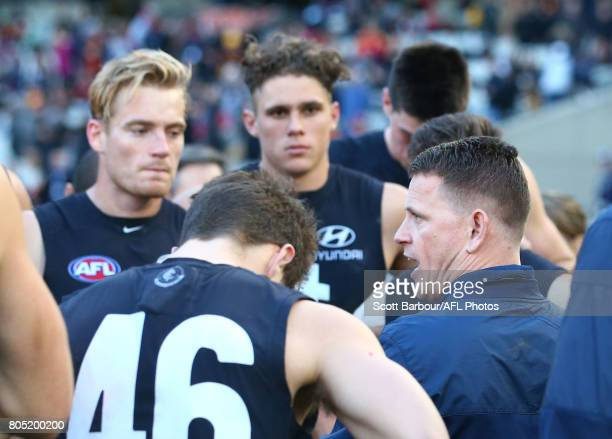 Blues head coach Brendon Bolton speaks to his team during a quarter time break during the round 15 AFL match between the Carlton Blues and the...
