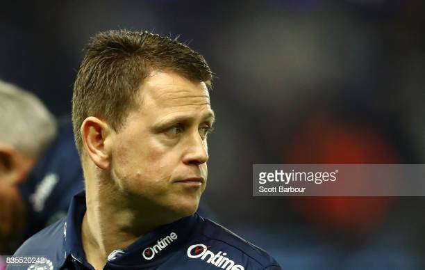 Blues head coach Brendon Bolton speaks to his team during a quarter time break during the round 22 AFL match between the Carlton Blues and the...