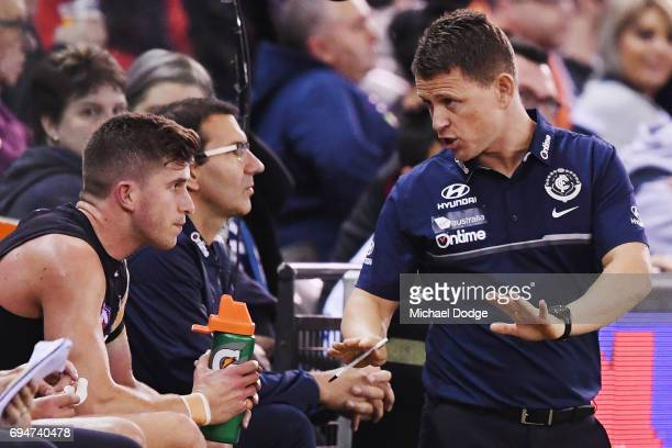 Blues head coach Brendon Bolton speaks to Marc Murphy of the Blues during the round 12 AFL match between the Carlton Blues and the Greater Western...