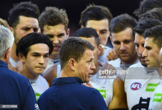 Blues head coach Brendon Bolton talks to his players during the round eight AFL match between the St Kilda Saints and the Carlton Blues at Etihad...