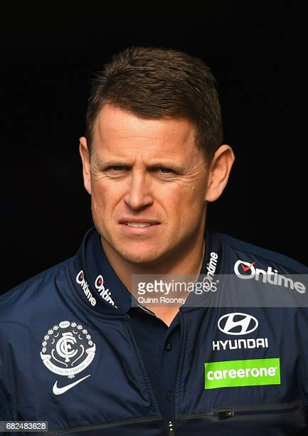Blues head coach Brendon Bolton walks out onto the field during the round eight AFL match between the St Kilda Saints and the Carlton Blues at Etihad...